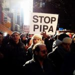 Protesters gather on 48th Street in Manhattan to speak against the SOPA and PIPA bills