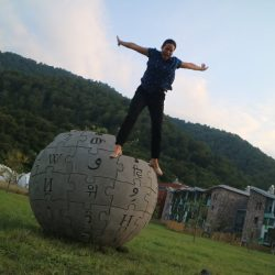 Wikimedian jumping from Wikipedia monument in Dilijan, Armenia
