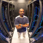 Man in front of computer servers