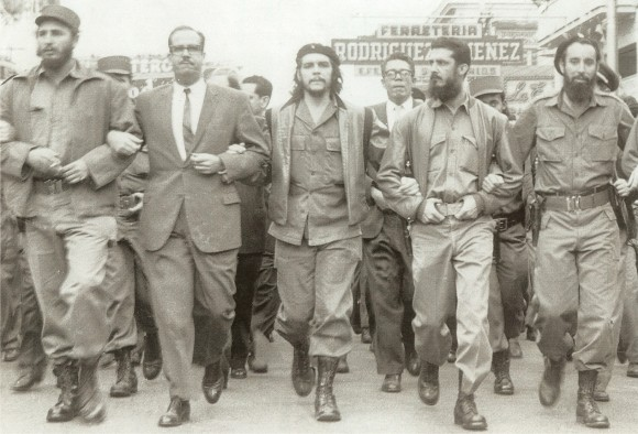 Castro (far left) marching with Che Guevara (center). Photo via Museo Che Guevara, public domain/CC0.