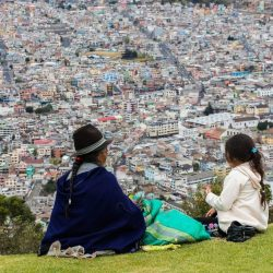 People overlooking Quito from Ecuador