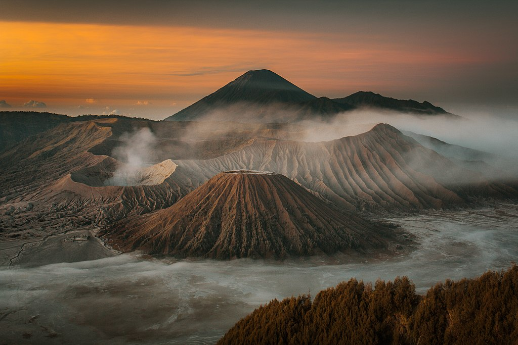 The sunset sneaks past Mount Bromo in Indonesia.