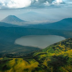 "The active volcano Ol Doinyo Lengai, or ""Mountain of God"" in Maasai, towering over Lake Natron in Tanzania."