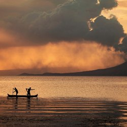 Merely two days after the violent eruption of Taal Volcano in the Philippines, the photographer visits its nearby lake to find locals fishing for tilapia despite imminent danger.