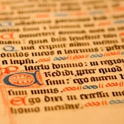 Close up photograph of handwritten, illuminated, calligraphic manuscript
