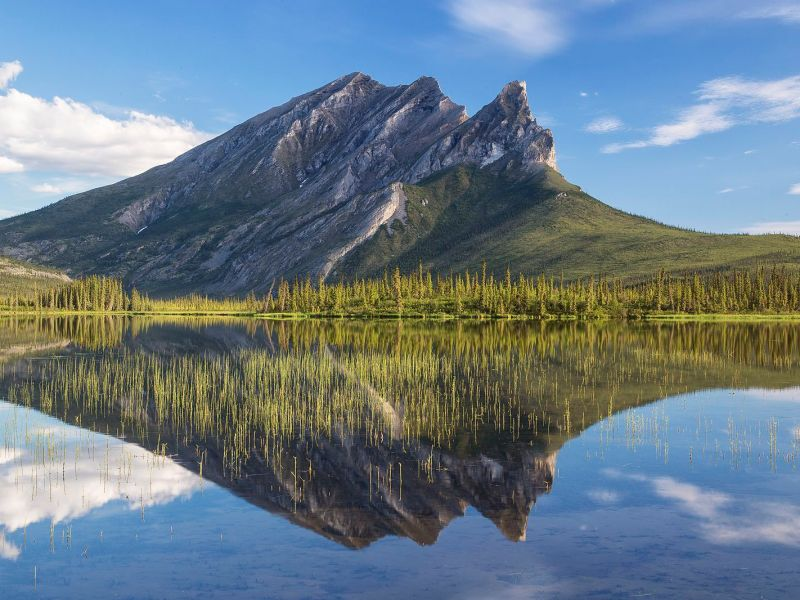 Photograph of Mount Sukakpak in Alaska and it's reflection in a clear lake.